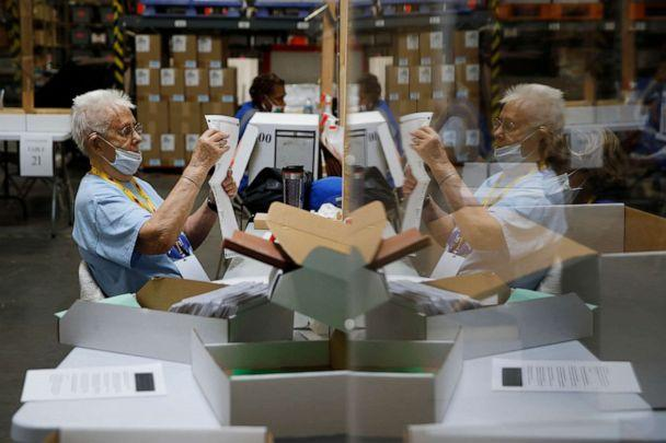 PHOTO: Election workers process mail-in ballots during a nearly all-mail primary election in Las Vegas. (John Locher/AP, FILE)
