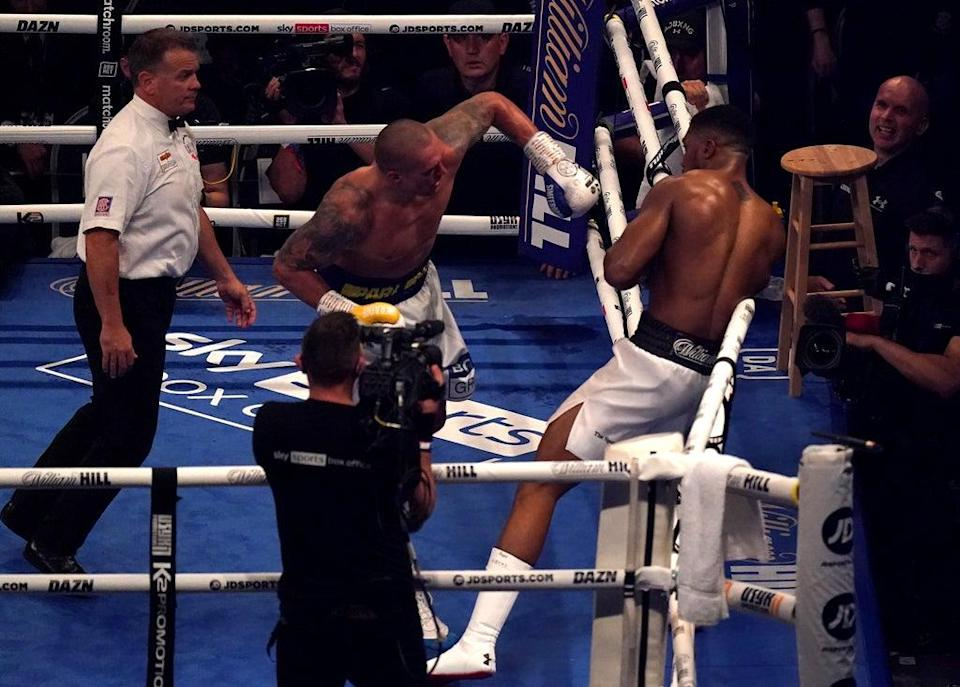 Anthony Joshua, right, ended the fight against Oleksandr Usyk slumped against the ropes (Nick Potts/PA) (PA Wire)