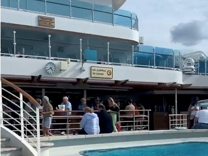 1 People onboard the Regal Princess cruise ship mingle near the pool area, following announcement of possible cornavirus (COVID 19) cases, as the vessel remains off the coast of Miami, Florida