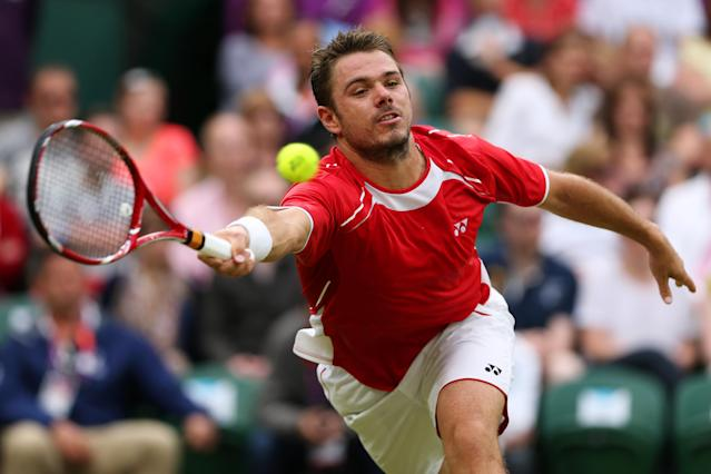 LONDON, ENGLAND - JULY 29: Stanislas Wawrinka of Switzerland plays a forehand during the Men's Singles Tennis match against Andy Murray of Great Britain on Day 2 of the London 2012 Olympic Games at the All England Lawn Tennis and Croquet Club in Wimbledon on July 29, 2012 in London, England. (Photo by Clive Brunskill/Getty Images)
