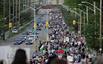 People march the 7km from a crime scene to a mosque in memory of a Muslim family that was killed in what police call a hate-motivated attack in London, Ontario