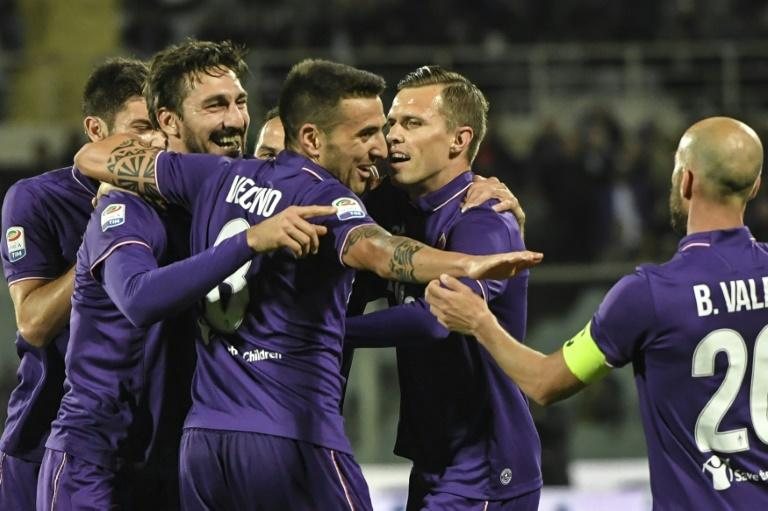 "Fiorentina's Davide Astori (2ndL) celebrates with teammates after scoring against Inter Milan, on April 22, 2017 at Florence's ""Artemio Franchi"" communal stadium"