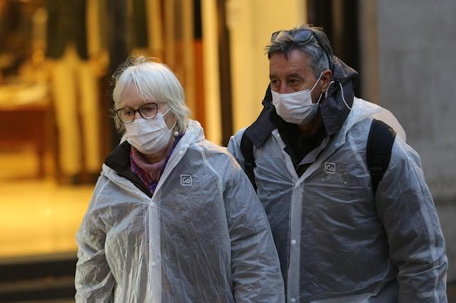 People wear medical masks as a precaution against coronavirus in central London on Monday (Getty Images)