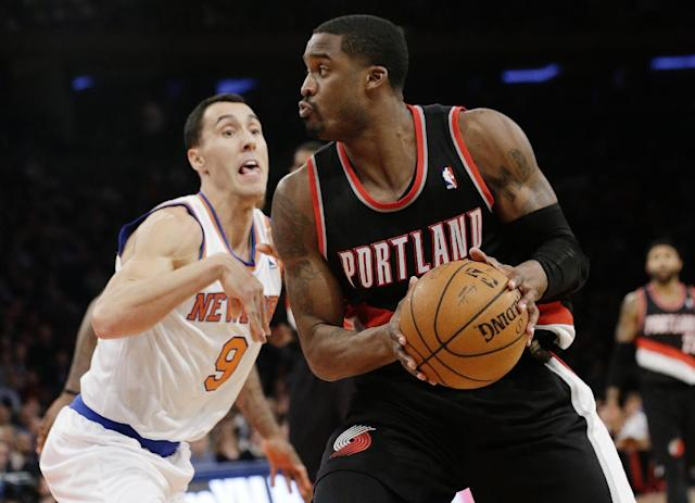 New York Knicks' Pablo Prigioni (9) defends Portland Trail Blazers' Wesley Matthews (2) during the second half of an NBA basketball game, Wednesday, Feb. 5, 2014, in New York. The Trail Blazers won the game 94-90. (AP Photo/Frank Franklin II)