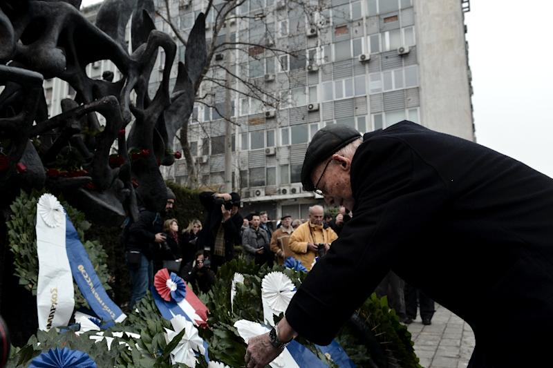 People lay flowers in January 2017 at the Holocaust Memorial in Thessaloniki, Greece, where eighty percent of the Jewish community was slaughtered during World War II