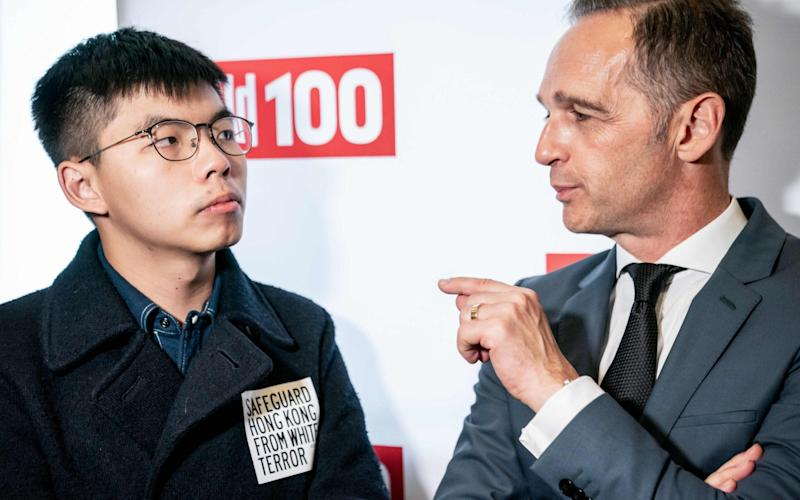 China is furious at a meeting between democracy activists Joshua Wong (left) and Heiko Maas, the German foreign minister (right) in Berlin - DPA