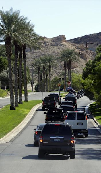 Motorcade vehicles for President Barack Obama, are seen leaving the Lake Las Vegas resort enroute to a local campaign office, Monday, Oct. 1, 2012 in Henderson, Nev. Sometimes all President Barack Obama has to do is look out the window to get a first-hand look at the country's economic woes. This week in this town, the presidential motorcade speeds past opulent homes lining manmade Lake Las Vegas as he heads to the sprawling luxury development where he's preparing for the upcoming debates with Mitt Romney. But many houses here are empty, victims of Nevada's foreclosure crisis, and others are worth far less than their purchase price. (AP Photo/Pablo Martinez Monsivais)