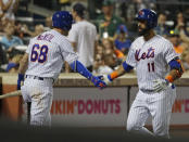 New York Mets' Jose Bautista (11) celebrates with teammate Jeff McNeil (68) after hitting a home run during the fourth inning of a baseball game against the San Francisco Giants non Wednesday, Aug. 22, 2018, in New York. (AP Photo/Frank Franklin II)