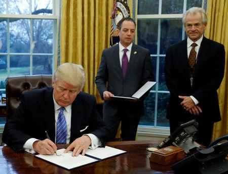 FILE PHOTO - President Trump signs executive orders at the White House in Washington
