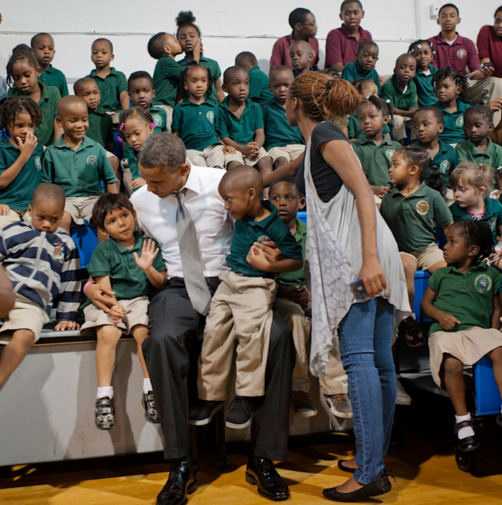 """A little romance steals the show: President Barack Obama visited students at Daughter of Zion Jr. Academy in Delray Beach, Fla., on Tuesday, Oct. 23, 2012, during an unscheduled stop after a campaign event. But the big surprise was the pair of kissing students on the top bleacher. (<a href=""""https://twitter.com/BarackObama/status/260926825843290112/photo/1"""" rel=""""nofollow noopener"""" target=""""_blank"""" data-ylk=""""slk:@BarackObama/Twitter"""" class=""""link rapid-noclick-resp"""">@BarackObama/Twitter</a>)"""