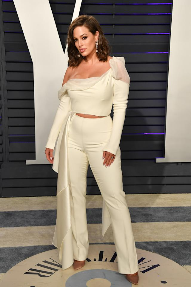 <p>For the <strong>Vanity Fair</strong> party following the Oscars, Graham changed from her black Zac Posen gown into a cream-colored, one-shouldered trouser suit, which featured a sheer neckline, wide-leg pants, and just a hint of midriff. </p>