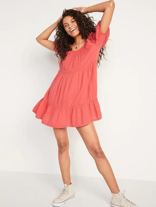 <p>Getting dressed will be a breeze when you pair a soft <span>Old Navy Tiered Puff-Sleeve Swing Dress</span> ($40) with your favorite high-tops.</p>