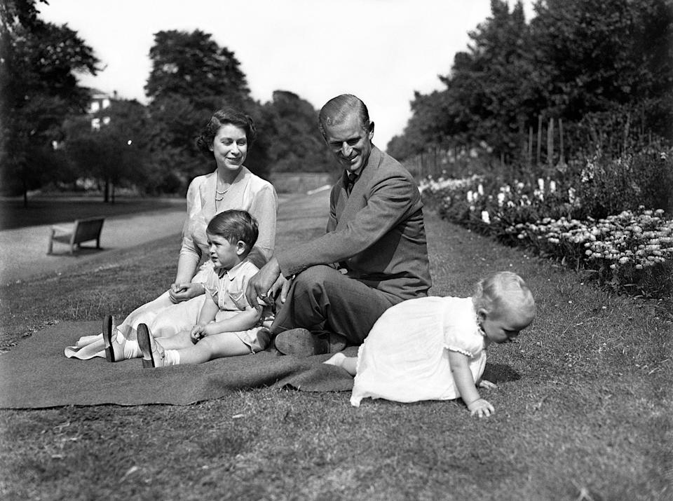 Then-Princess Elizabeth with the Duke of Edinburgh, Charles and Anne on the grounds of Clarence House, their London residence.