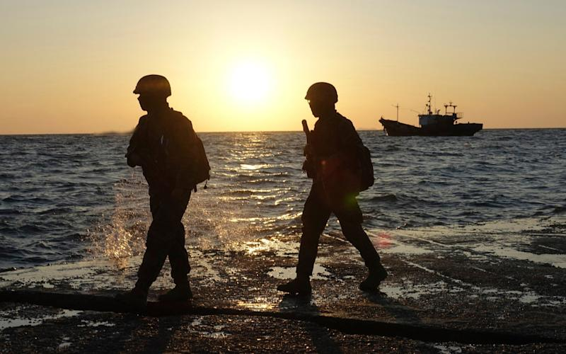 South Korean marine soldiers patrol on Yeonpyeong island - Yonhap