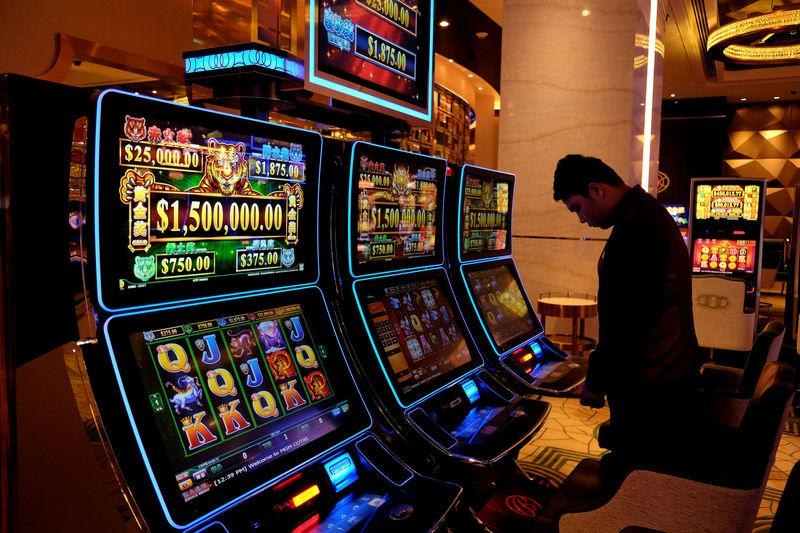FILE PHOTO: Gaming machines are installed at the casino of MGM Cotai in Macau