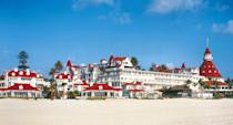 <p><strong>How did it strike you on arrival?</strong><br> You can spot the iconic red turrets from the plane. The beachfront Victorian-style hotel is grand, a San Diego icon featured in the Marilyn Monroe flick <em>Some Like It Hot</em>. Hilton bought the Del, so you're bound to see a few chain-hotel qualities though (like a generic bathroom).</p> <p>It feels less like a traditional resort and more like a retail complex open to the public, with shops, restaurants, walking paths, and an ice skating rink during the holidays (in addition to its guest rooms).</p> <p><strong>What's the crowd like?</strong><br> You'll see couples, families, low-key bachelorette parties, celebrities in town for Comic-Con, and business travelers.</p> <p><strong>Importantly: Tell us about the rooms.</strong><br> The Victorian building has old-school vibes with Queen Anne-style architecture, while California Cabanas and Ocean View Towers skew more modern and are located closer to the beach and pool.</p> <p>If you really want to splash out, book a room in the Beach Village, the Del's secluded cottages by the ocean with a private valet and separate entrance. Decor in all is simple, clean, and unfussy—nothing crazy to note. That said, know that the appeal here is the hotel as a whole, not just your room. Doubles at Hotel del Coronado start at $369, and Beach Village cottages start at $925.</p> <p><strong>How about the little things, like mini bar, or shower goodies. Any of that worth a mention?</strong><br> The TV streams Netflix, Pandora, YouTube, Hulu (included in the daily resort fee).</p> <p><strong>Please tell us the bathroom won't let us down.</strong><br> While the rest of the hotel is pretty epic, the bathrooms are ho-hum—and small.</p> <p><strong>We all need some good Wi-Fi. What's the word on that?</strong><br> The $35 resort fee is lumped into the room rate and includes Wi-Fi, as well as beach yoga, in-room Netflix, and discount tickets to Legoland and other area landmarks.</p> <p><st