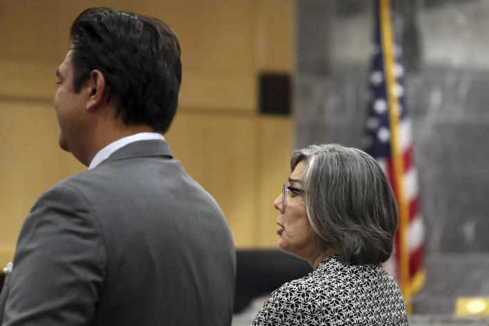 Prosecutor Maria Schneider,right, and defense attorney David Wheeler are shown during a pre-trial hearing for Parkland school shooter Nikolas Cruz at the Broward County Courthouse in Fort Lauderdale, Fla., Wednesday, July 14, 2021. Cruz is accused of punching Sgt. Ray Beltran, wrestling him to the ground and taking his stun gun November 2018. (Amy Beth Bennett/South Florida Sun-Sentinel via AP, Pool)