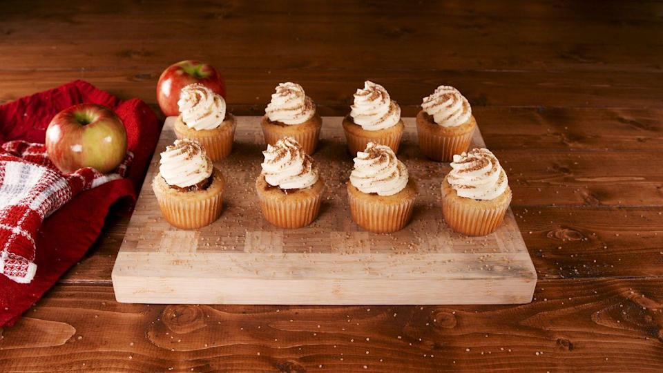 """<p>These scrumptious cupcakes stuffed with warm, gooey <a href=""""https://www.goodhousekeeping.com/food-recipes/dessert/a29439992/apple-pie-with-cheddar-cheese-crust-recipe/"""" rel=""""nofollow noopener"""" target=""""_blank"""" data-ylk=""""slk:apple pie"""" class=""""link rapid-noclick-resp"""">apple pie</a> filling take the saying """"as American as apple pie"""" to a whole new level. <br></p><p><em><a href=""""https://www.delish.com/cooking/recipe-ideas/a29443041/apple-pie-cupcakes-recipe/"""" rel=""""nofollow noopener"""" target=""""_blank"""" data-ylk=""""slk:Get the recipe from Delish »"""" class=""""link rapid-noclick-resp"""">Get the recipe from Delish » </a> </em></p>"""