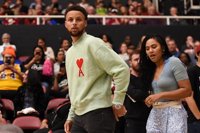 "NBA star <a class=""link rapid-noclick-resp"" href=""/nba/players/4612/"" data-ylk=""slk:Stephen Curry"">Stephen Curry</a>, pictured with his wife Ayesha at a Stanford game in February, used his platform to share an interview with Dr. Anthony Fauci. (Photo by Cody Glenn/Icon Sportswire via Getty Images)"