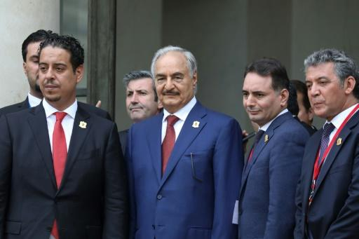 Marshal Khalifa Haftar, whose self-styled Libyan National Army dominates the country's east, stands with his delegation on the steps of the Elysee Palace as they leave following the International conference on Libya in Paris on May 29, 2018