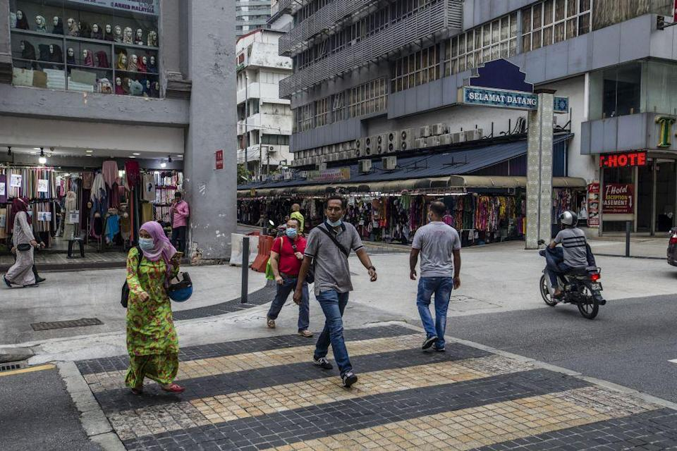 Members of the public walk along Jalan Tuanku Abdul Rahman amid the conditional movement control order in Kuala Lumpur October 23, 2020. — Picture by Firdaus Latif