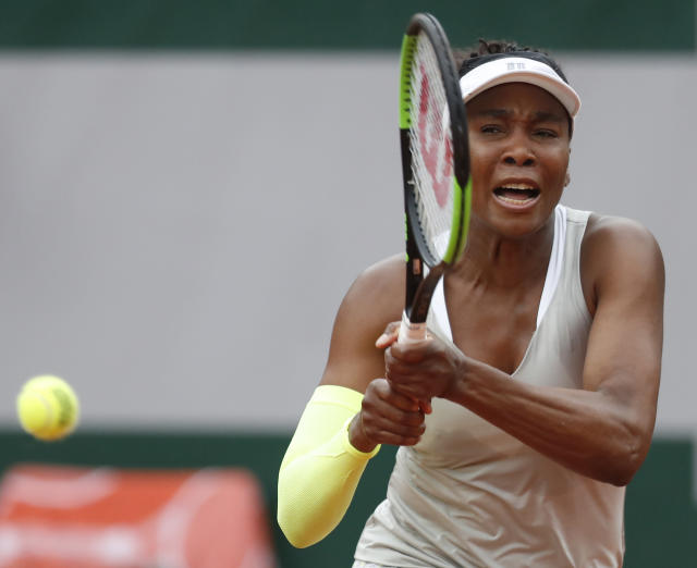 Venus Williams of the U.S. plays a shot against Ukraine's Elina Svitolina during their first round match of the French Open tennis tournament at the Roland Garros stadium in Paris, Sunday, May 26, 2019. (AP Photo/Pavel Golovkin)