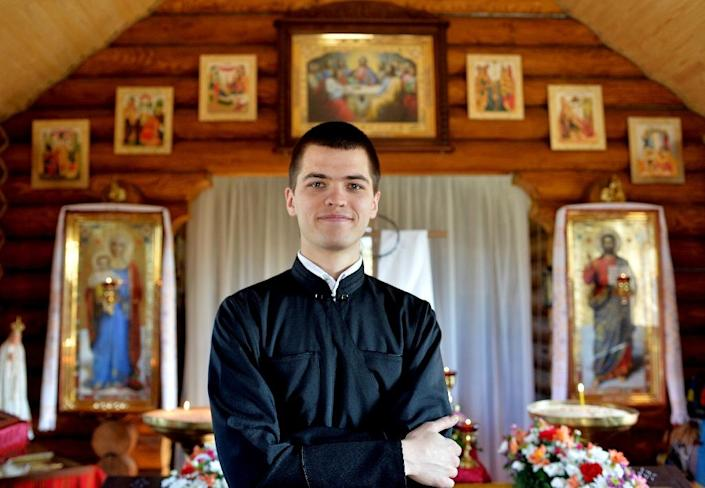 Seminarian Oleg, 21, poses for a photograph on April 11, 2015 in the small wooden chapel above the Maidan, the scene of deadly protests in 2014 that shaped Ukraine's history (AFP Photo/Genya Savilov)