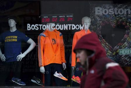 A digital clock on an athletic store front near the finish of the Boston Marathon, counts down the time to the 118th running of the Boston Marathon
