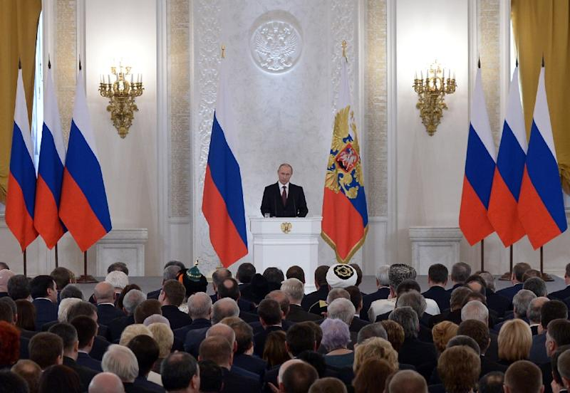 Russia's President Vladimir Putin addresses a joint session of parliament in the Kremlin in Moscow, on March 18, 2014