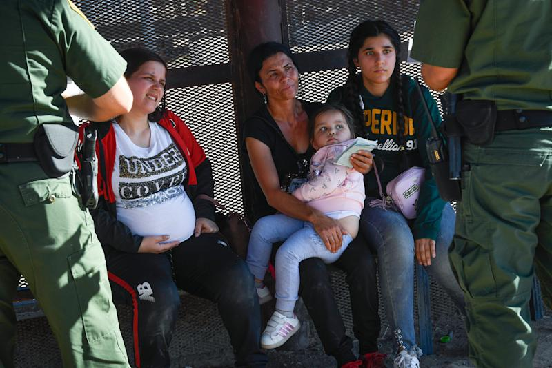 6/27/19 5:54:14 PM -- San Luis, Arizona -- United States Border Control agents talk to a pregnant woman with her three-year old child and a 41-year-old woman with her 13-year-old daughter. They spoke no English, just enough to ask for water.