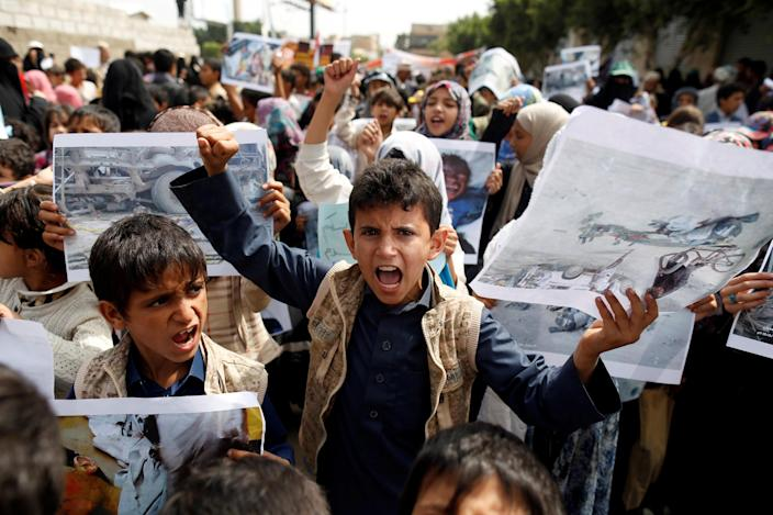 Boys demonstrate outside the offices of the United Nations in Sanaa, Yemen, to denounce an airstrike that killed dozens, including children, in the northwestern province of Saada in August. (Photo: Khaled Abdullah/Reuters)
