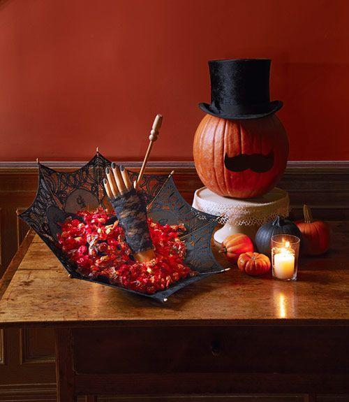 <p>Protruding from a lace parasol, a disembodied hand tests the fearlessness of trick-or-treaters — are they brave enough to grab candy from such a spooky server? Only time will tell. </p>
