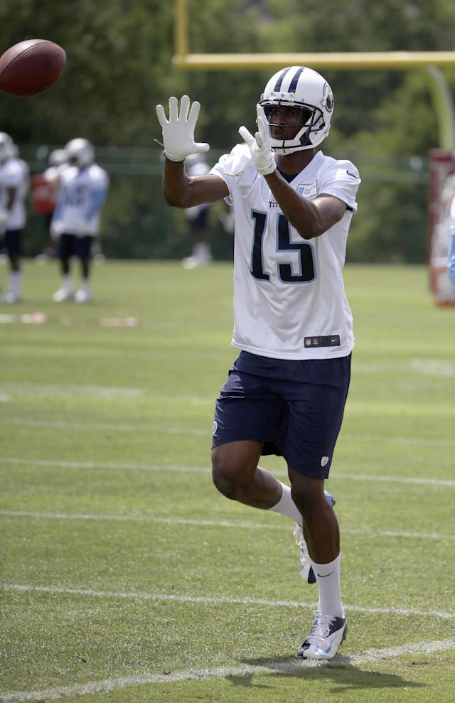 FILE - In this June 12, 2014, file photo, Tennessee Titans wide receiver Justin Hunter catches a pass during NFL football practice in Nashville, Tenn. Hunter has added about 15 pounds of muscle for his second NFL season. (AP Photo/Mark Humphrey, File)