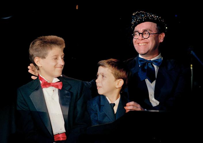 """AIDS activist Ryan White is seen far left of British pop singer Elton John at the """"For the Love of Children"""" benefit for children with AIDS and other serious illnesses in Los Angeles in 1988. (Photo: ASSOCIATED PRESS)"""
