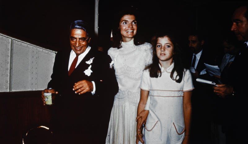 (Original Caption) Bearing traces of confetti, Mr. and Mrs. Aristotle Onassis, (Jackie Kennedy), are shown at their October 20th wedding on Onassis' private island. Caroline Kennedy, 10, stands next to her mother.