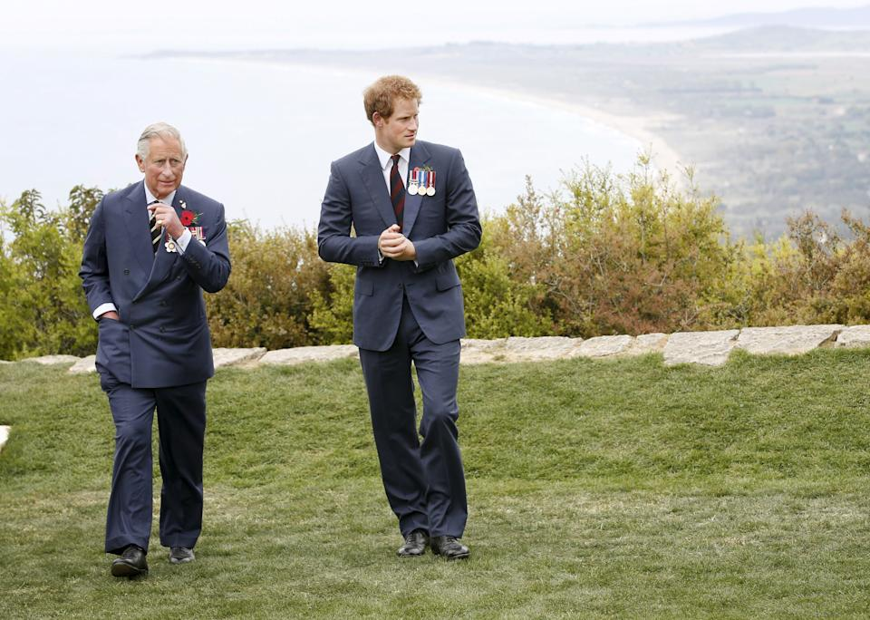 Britain's Prince Harry (R) and Prince Charles, Prince of Wales, look on during a visit to The Nek Cemetery, in Gallipoli, Turkey, April 25, 2015. Leaders and dignitaries from Australia, New Zealand and Turkey led thousands at dawn ceremonies on Turkey's Gallipoli peninsula on Saturday to mark the 100th anniversary of a World War One battle that helped shape their nations.  REUTERS/David Caird/Pool