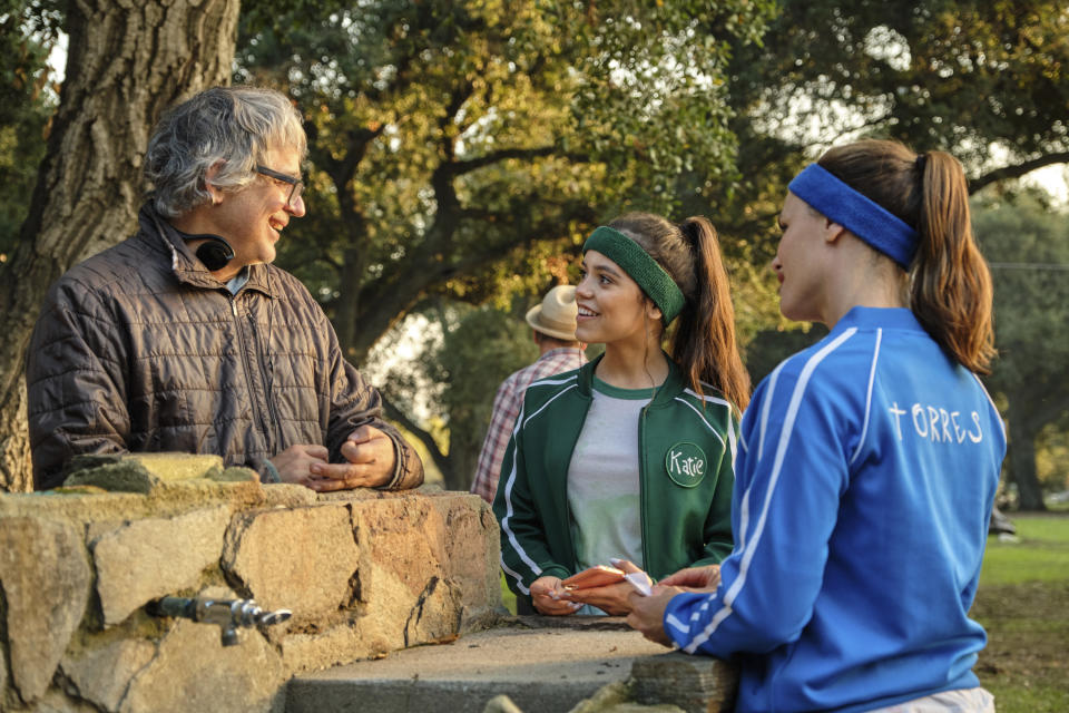 """Director Miguel Arteta, from left, appears on the set of his film """"Yes Day"""" with actors Jenna Ortega and Jennifer Garner. (John P. Johnson/Netflix via AP)"""