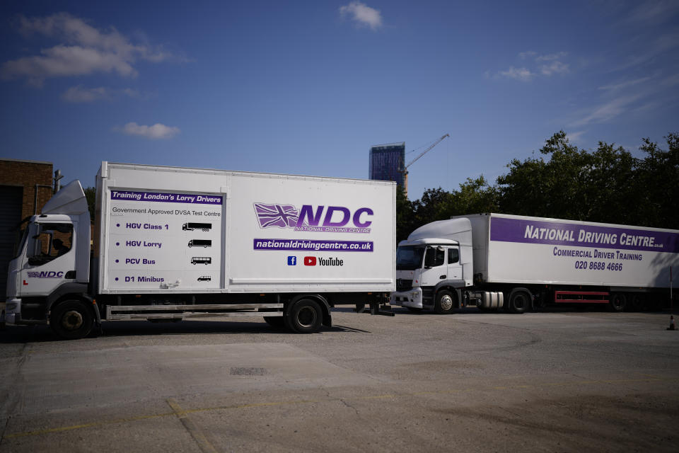 A learner truck driver sits in the cab of a training truck at the National Driving Centre in Croydon, south London, Wednesday, Sept. 22, 2021. Britain doesn't have enough truck drivers. The shortage is contributing to scarcity of everything from McDonald's milkshakes to supermarket produce. (AP Photo/Matt Dunham)