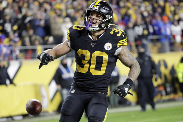 "FILE - In this Dec. 15, 2019, file photo, Pittsburgh Steelers running back James Conner (30) plays during the second half of an NFL football game against the Buffalo Bills in Pittsburgh. Conner stressed he's not concerned about his future as he enters the final year of his contract. The team declined to offer him an extension following three seasons in which he has struggled to stay healthy. ""That's the game,"" Conner said.(AP Photo/Don Wright, File)"