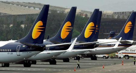 FILE PHOTO: Jet Airways aircraft stand on tarmac at the domestic airport terminal in Mumbai