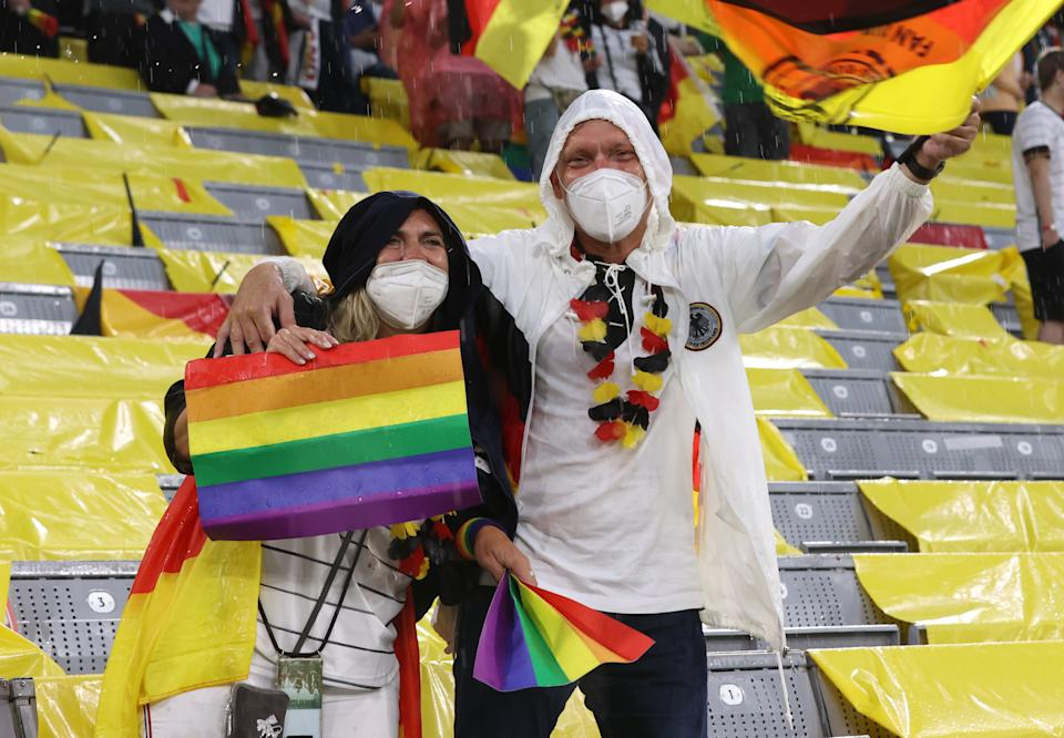 MUNICH, GERMANY - JUNE 23: Fans of Germany hold up rainbow flags prior to the UEFA Euro 2020 Championship Group F match between Germany and Hungary at Allianz Arena on June 23, 2021 in Munich, Germany. (Photo by Alexander Hassenstein/Getty Images)