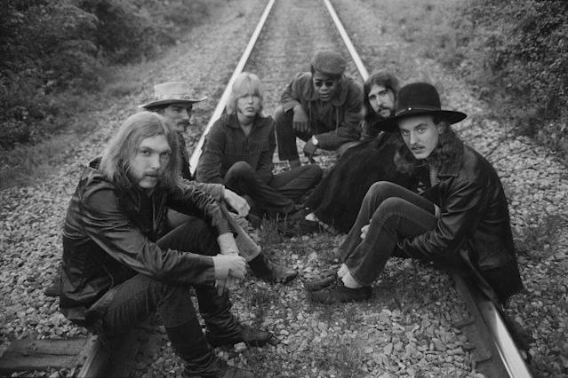 The Allman Brothers, from left, Duane Allman, Dickey Betts, Gregg Allman, Jai Johanny Johanson, Berry Oakley, and Butch Trucks, sit on some railroad tracks on May 5, 1969, outside of Macon, Georgia. (Photo by Michael Ochs Archives/Getty Images)