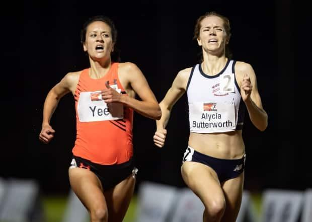Regan Yee, left, and Alycia Butterworth at the finish line of the women's 3,000 metres steeplechase during the Harry Jerome International Track Classic in Burnaby, B.C., on June 12. Both women have qualified to race for Canada at the Tokyo Olympic Games. (Darryl Dyck/The Canadian Press/File - image credit)