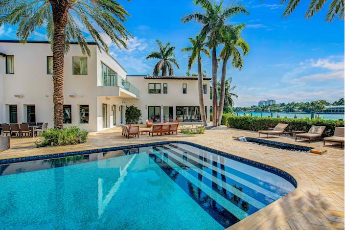 Out back, the property features a pool and a view of Biscayne Bay.