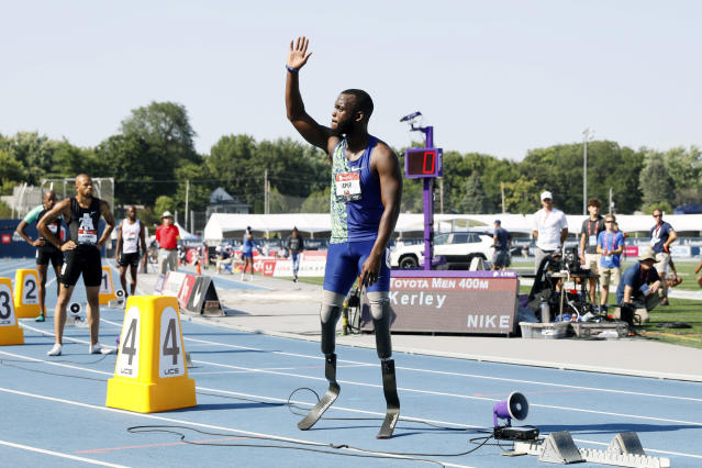 Blake Leeper waves to the crowd before the men's 400-meter dash at the U.S. Championships athletics meet, Saturday, July 27, 2019, in Des Moines, Iowa. (AP Photo/Charlie Neibergall)