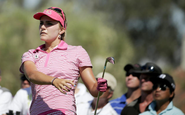 Lexi Thompson watches her tee shot on the fifth hole during the third round of the Kraft Nabisco Championship golf tournament Saturday, April 5, 2014, in Rancho Mirage, Calif. (AP Photo/Chris Carlson)