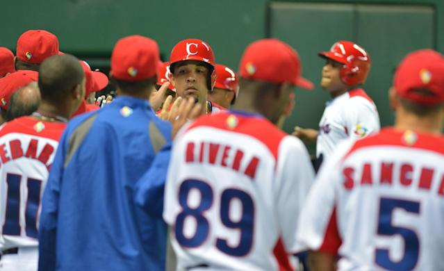 Cuba's Jose Abreu (C, rear) is congratulated by teammates after his grand slam against China during the fifth inning of their first-round Pool A game in the World Baseball Classic tournament in Fukuoka on March 4, 2013. AFP PHOTO / KAZUHIRO NOGIKAZUHIRO NOGI/AFP/Getty Images