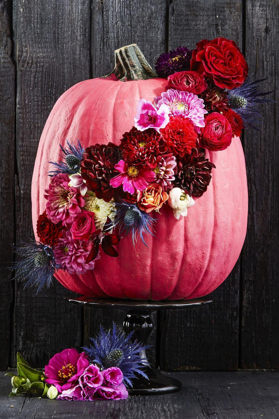 "<p>This hot pink gourd earns centerpiece status thanks to a sash of fresh blooms. Snip stems about one to two inches from buds, drill small holes in the painted rind, then stick in the buds. Keep flowers looking perky by periodically spritzing with water. </p><p><a class=""link rapid-noclick-resp"" href=""https://www.amazon.com/dp/B001K6191C?tag=syn-yahoo-20&ascsubtag=%5Bartid%7C10055.g.1566%5Bsrc%7Cyahoo-us"" rel=""nofollow noopener"" target=""_blank"" data-ylk=""slk:SHOP PINK PAINT"">SHOP PINK PAINT</a></p>"