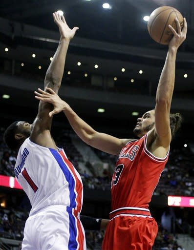 Chicago Bulls center Joakim Noah, right, goes to the basket against Detroit Pistons forward Andre Drummond (1) during the first half of an NBA basketball game, Friday, Dec. 7, 2012, in Auburn Hills, Mich. (AP Photo/Duane Burleson)