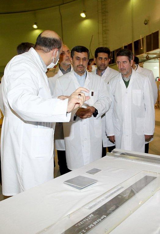 A picture released by Iranian President Mahmoud Ahmadinejad's website shows him (centre) and Foreign Minister Ali AKbar Salehi (behind him) listening to an expert during a tour of Tehran's research reactor centre on February 15, 2012. Iran features prominently among the list of North Korea's potential nuclear clients put forward by analysts